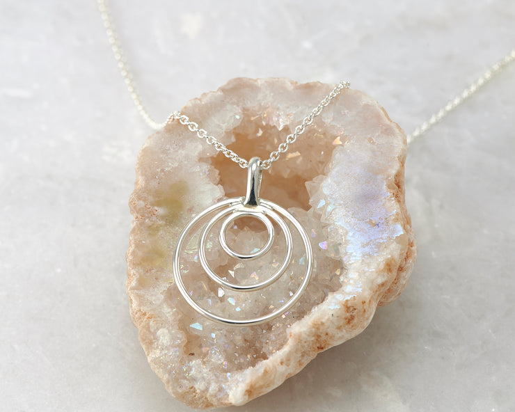 silver circles necklace on quartz