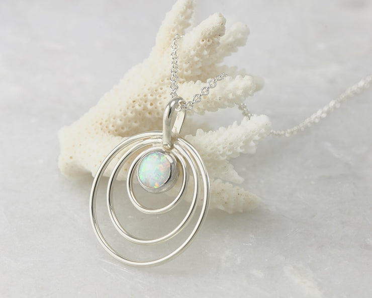 Silver opal circles necklace on coral