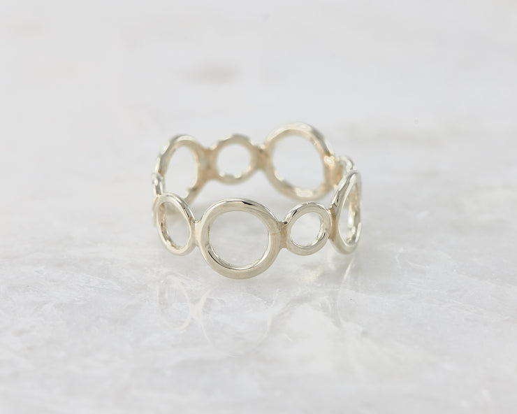 statement circles ring on white marble