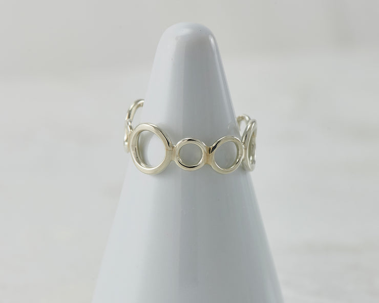 Silver circles ring on white ring holder