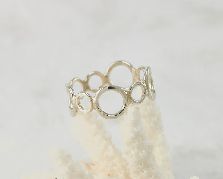 circles silver statement ring on coral
