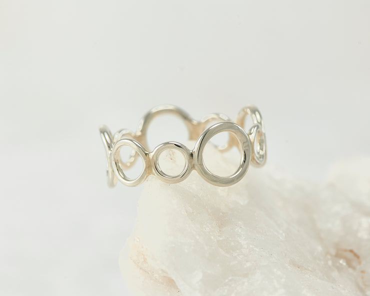 Silver circles statement ring on white rock