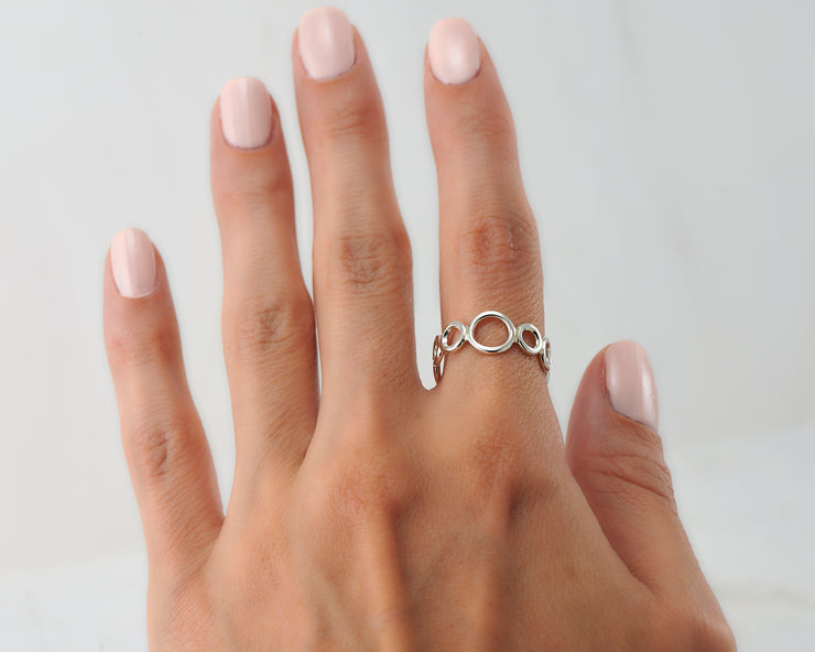 Woman wearing statement circles ring