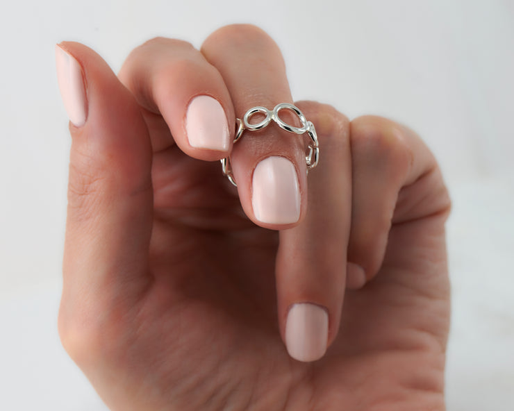 Woman wearing circles statement silver ring