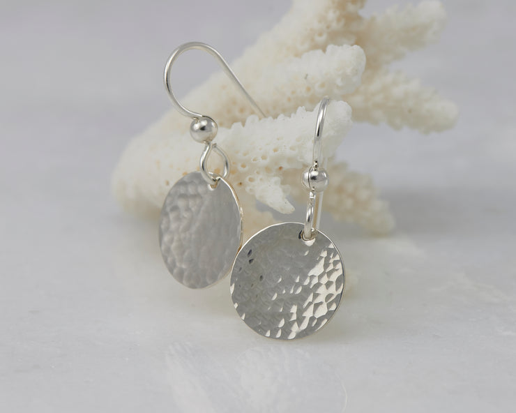 Sterling Silver earrings hanging from coral