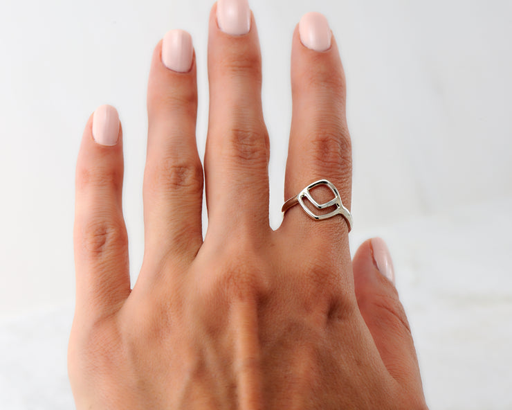 Woman wearing chevron geometric ring