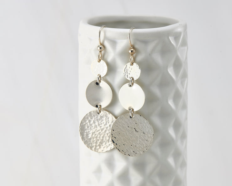 Disc Dangle Earrings on geometric vase