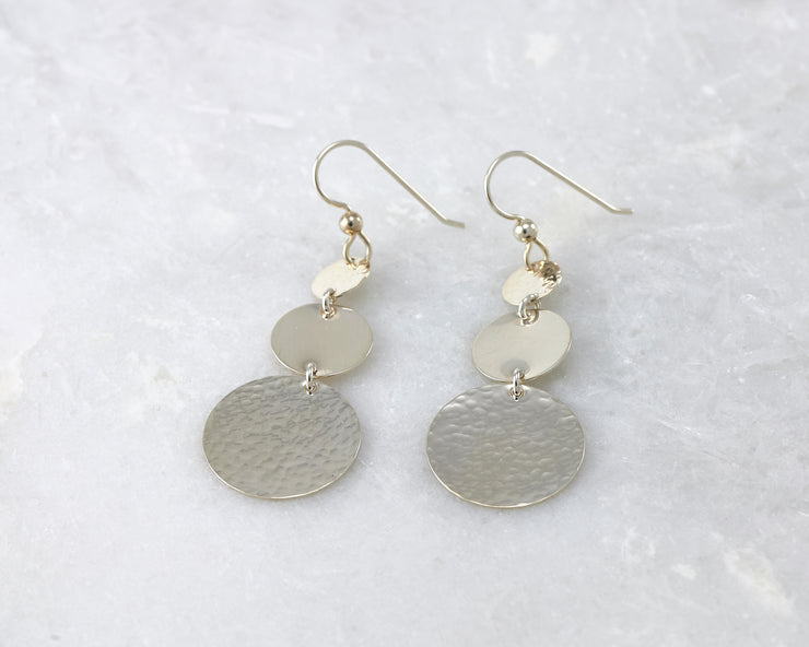 Silver Hammered earrings on white marble