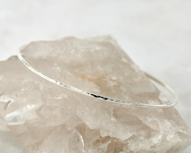 hammered latch bangle bracelet shown on crystal rock
