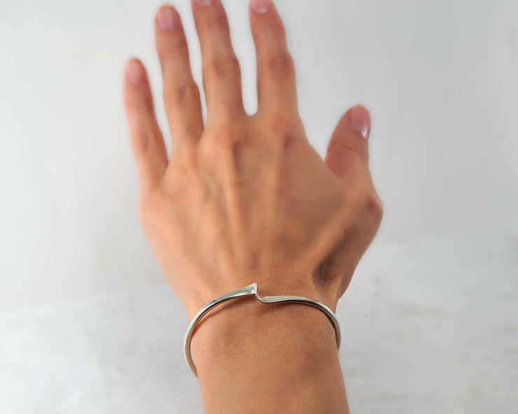 Woman wearing silver wave cuff bracelet