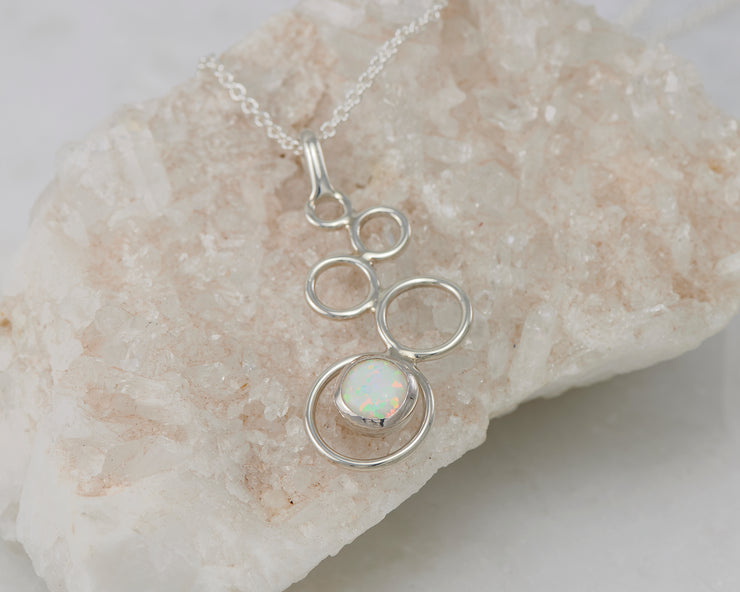 Silver opal necklace on crystal rock
