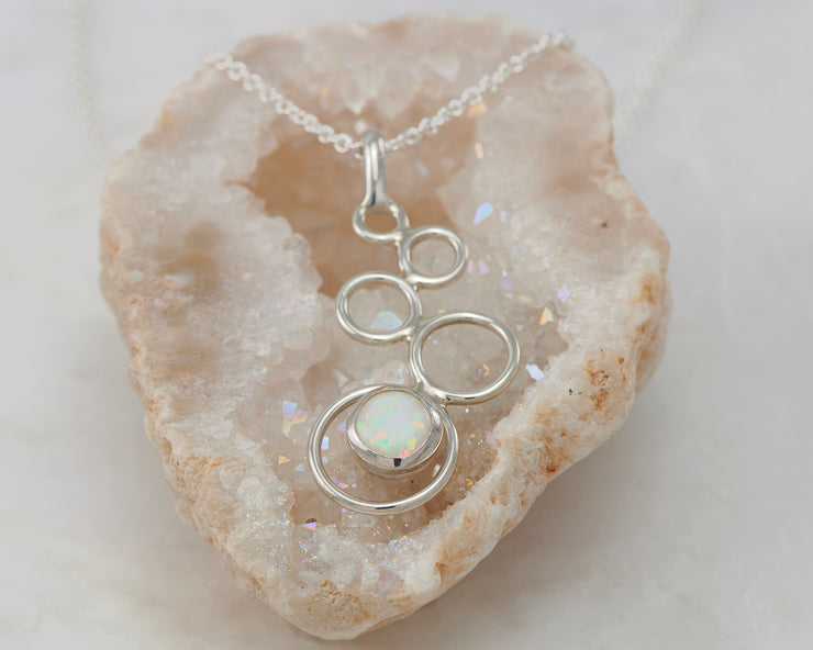 silver opal necklace on quartz