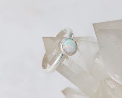 silver opal ring on crystal rock