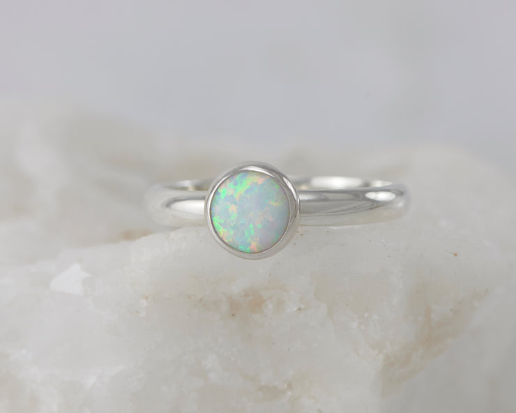 silver opal ring on white rock