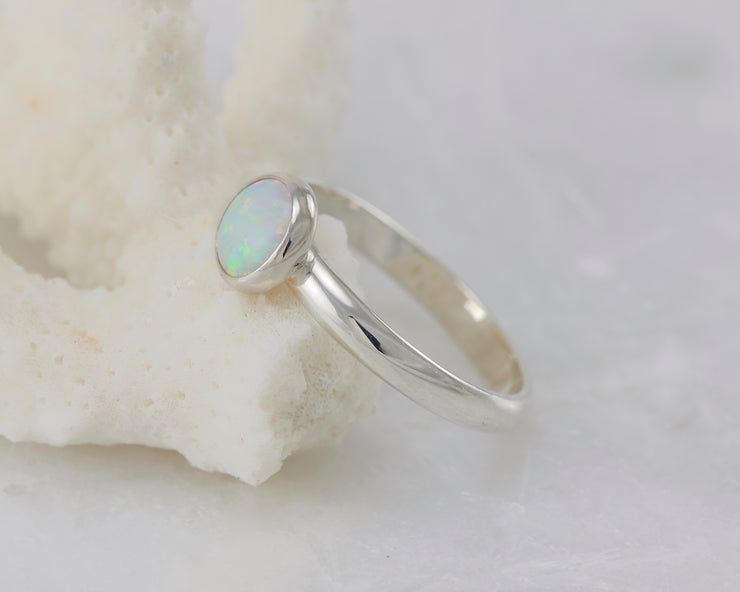 opal ring on coral