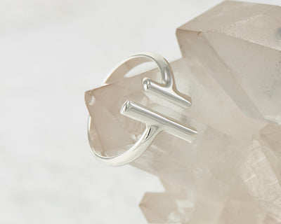 parallel bars ring on crystal rock