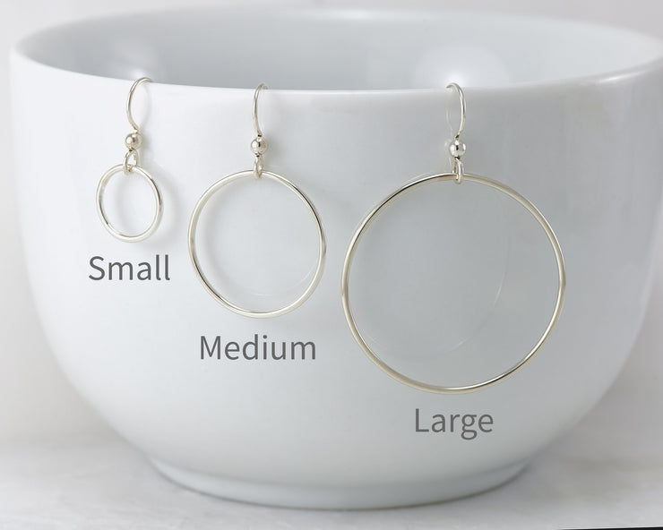 silver hoop earrings in small, medium, and large