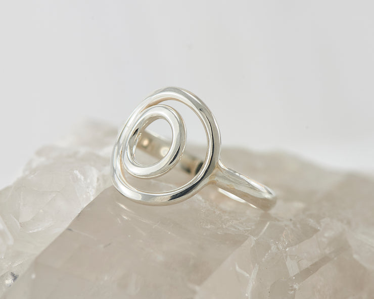silver circles ring on crystal rock
