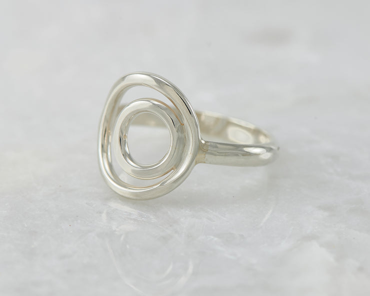 simple circles silver ring on white marble