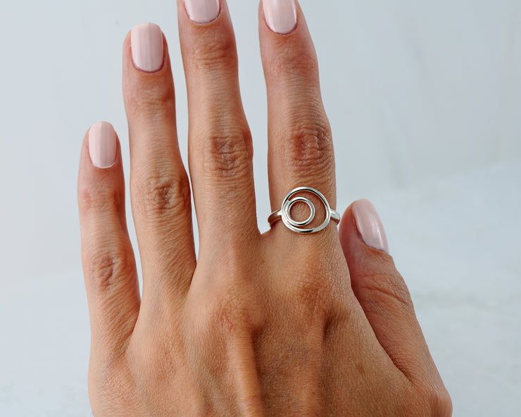 woman wearing silver circles ring