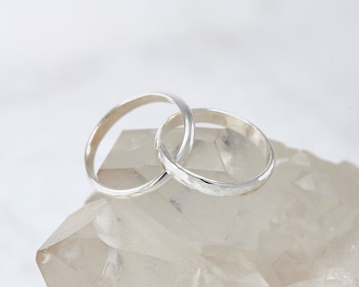 interlocking russian wedding rings on crystal rock