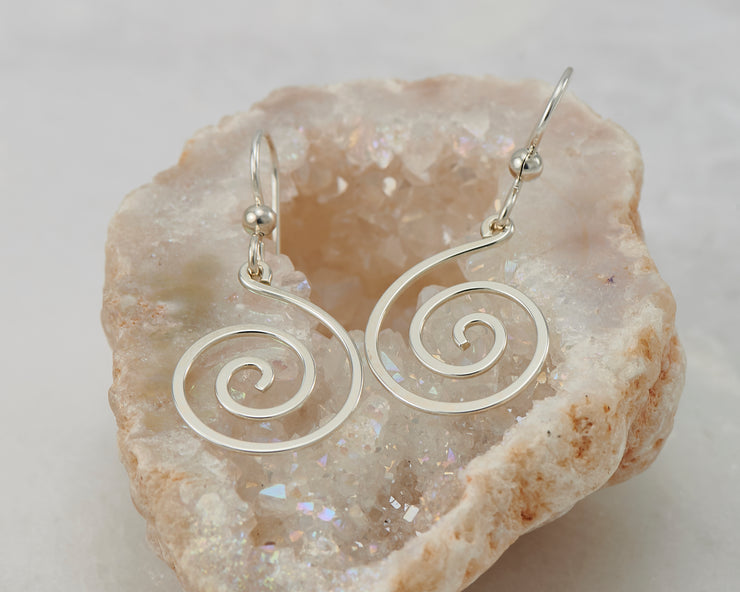 silver spiral earrings on quartz