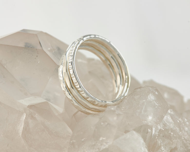 Silver hammered stacking rings on crystal rock