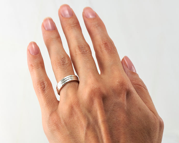 woman wearing silver stacking ring set