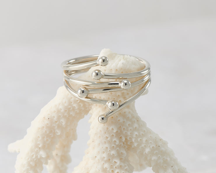 Silver statement ring on coral