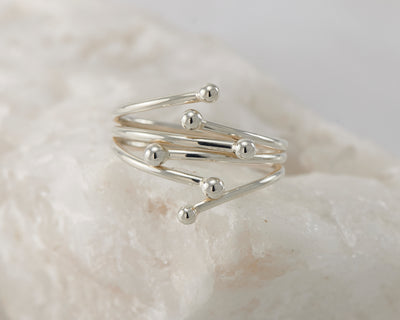 Silver statement wrap ring on white rock