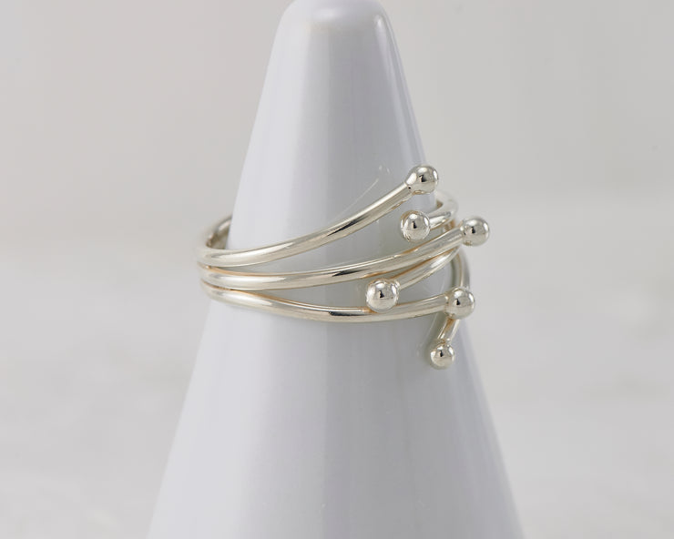Silver statement wrap ring on white ring holder