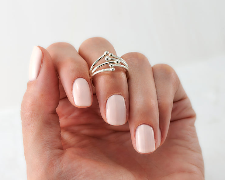 Woman holding statement silver ring