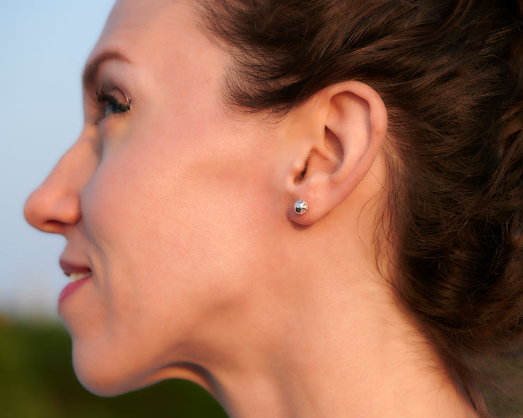 Woman wearing silver ball stud earrings