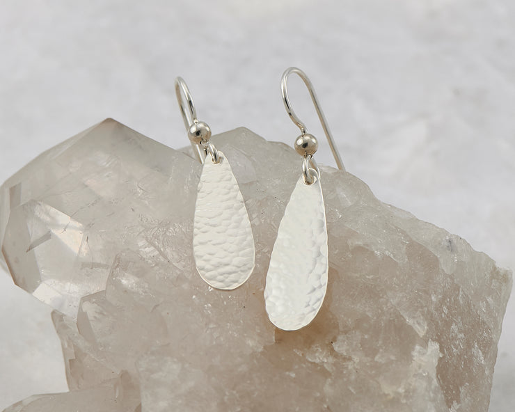 Silver teardrops earrings on crystal rock