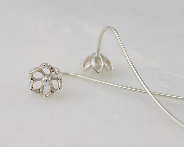 close-up of silver threader earrings