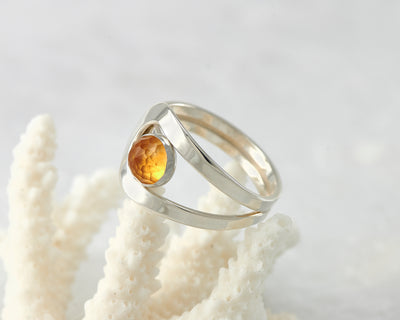 Silver citrine ring on coral