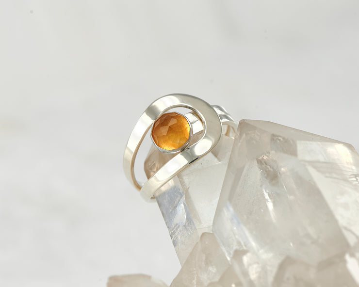 citrine wrap ring on crystal rock