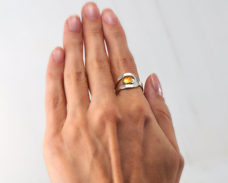 Woman wearing wrap citrine ring