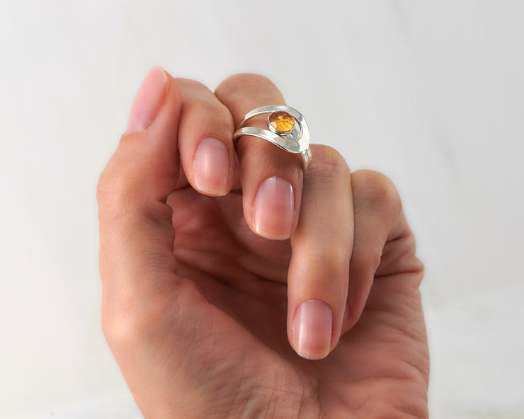 Woman holding citrine silver ring
