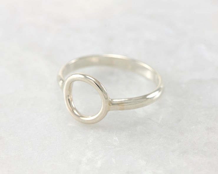 simple circle silver ring on white marble