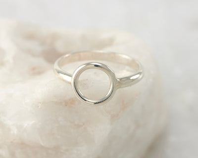 silver circle ring on white rock
