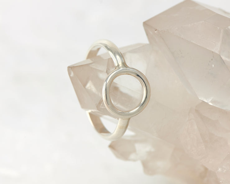 silver cirle ring on crystal rock