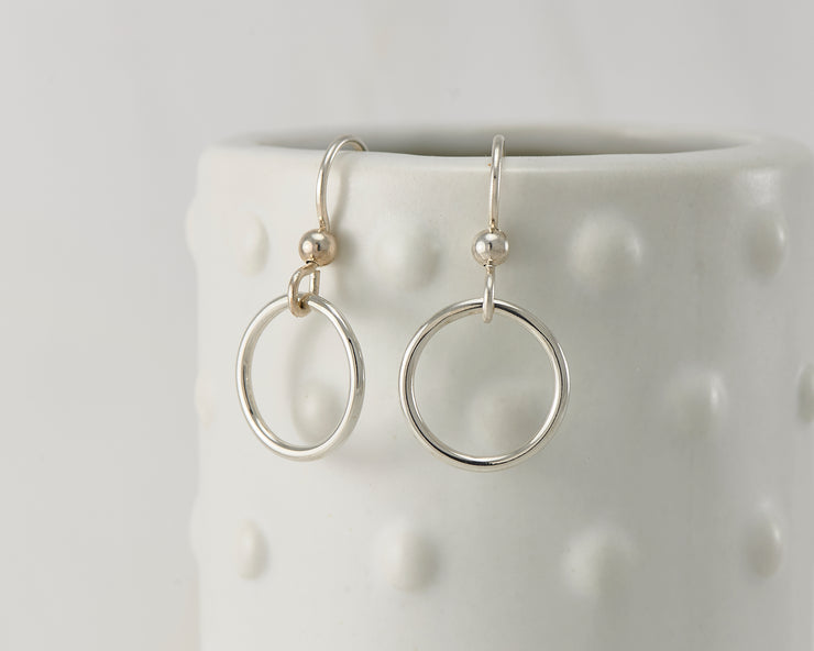 silver small hoop earrings on dotted vase