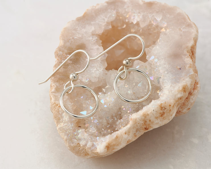silver small hoop earrings on quartz
