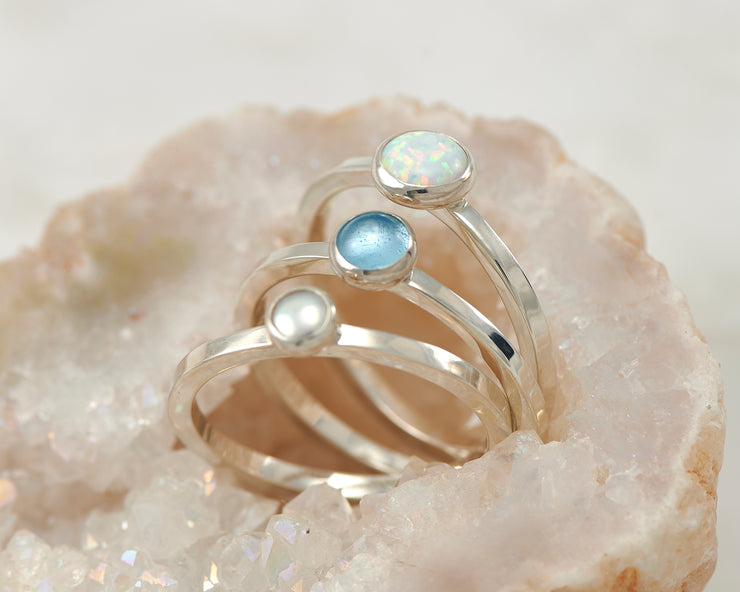 central opal, pearl, blue topaz ring in quartz