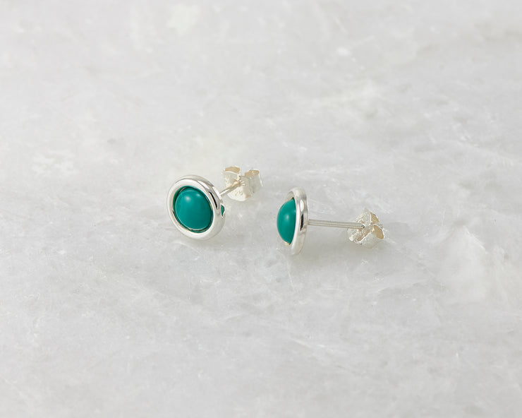 simple turquoise silver stud earrings on white marble