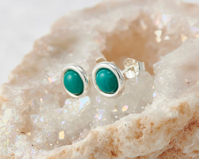 silver turquoise stud earrings on quartz