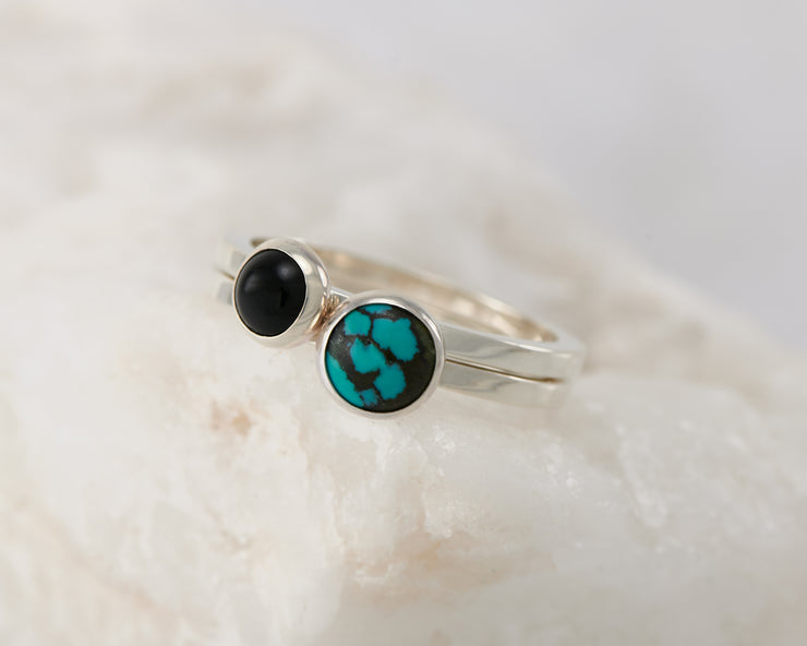 silver stacking rings turquoise and black onyx on white rock