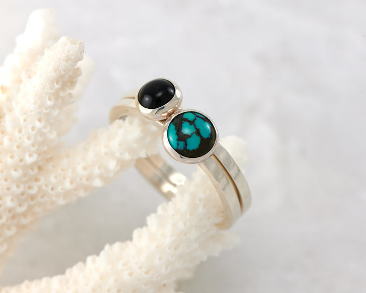 turquoise and black onyx ring on coral