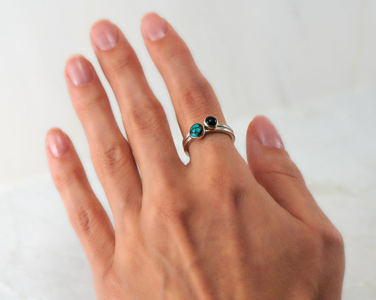 woman wearing turquoise & black onyx stacking rings